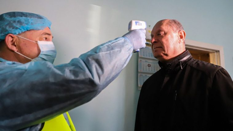 Nursing Homes Secure Doors and Check Entering People's Temperatures